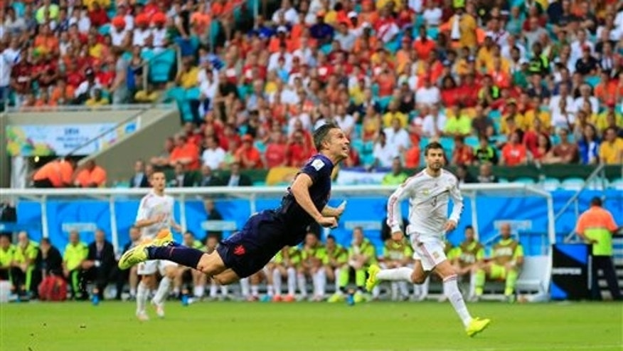 Netherlands' Robin van Persie scores a goal during the group B World Cup soccer match between Spain and the Netherlands at the Arena Ponte Nova in Salvador, Brazil, Friday, June 13, 2014. (AP Photo/Bernat Armangue)