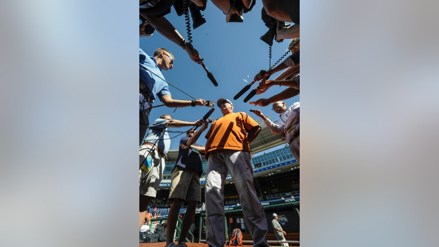 Texas coach Augie Garrido talks to reporters during team practice, Friday, June 13, 2014, ahead of the NCAA baseball College World Series tournament at TD Ameritrade Park in Omaha, Neb. UC Irvine plays Texas on Saturday. (AP Photo/Dave Weaver)