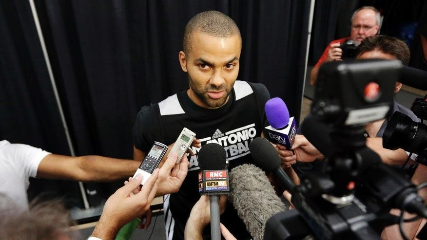 "File-This June 15, 2013, file photo shows San Antonio Spurs' Tony Parker answering questions during a media availability after NBA basketball practice, , in San Antonio. Parker, a Belgian-born guard who plays for France and had a big international following even before signing with Peak last year, toured China, home of the world's second-largest economy, behind only the United States, last summer. ""I love traveling and going to China was an unbelievable experience,"" Parker said. ""It was my third time. Brought my whole family. It was the first time for them. So we just had a great memories and great experience, and they really took care of me. It's just great to see another side of the world and interact with your fans. Just had a great time."" (AP Photo/David J. Phillip, File)"