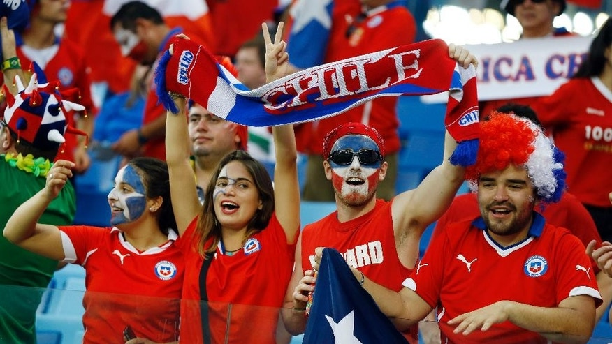 Chilean fans cheer before the start of the group B World Cup soccer match between Chile and Australia in the Arena Pantanal in Cuiaba, Brazil, Friday, June 13, 2014.  (AP Photo/Kirsty Wigglesworth)
