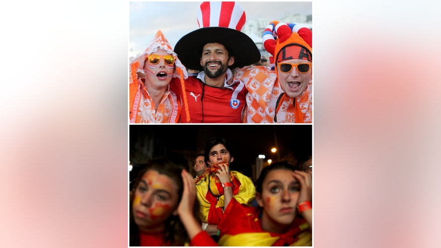 In this combination of Associated Press photos Dutch soccer fans, top, pose for a photo inside the FIFA Fan Fest area on Copacabana beach in Rio de Janeiro, Brazil, and Spanish soccer fans, bottom, in Madrid, watch on a giant display as the Netherlands defeat Spain during a World Cup soccer match Friday, June 13, 2014. (AP Photo)