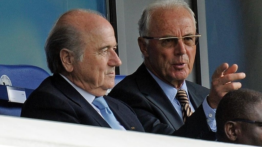 FILE - The Aug. 1, 2010 file photo shows FIFA president Sepp Blatter and German soccer legend Franz Beckenbauer, from left,  on the tribune during the FIFA U20 Women's World Cup final soccer match between Germany and Nigeria in Bielefeld, Germany. Beckenbauer has been banned from football duty for 90 days for snubbing an investigation into Qatar's 2022 World Cup bid. FIFA said Friday, June 13, 2014 the 90-day provisional ban was requested by ethics prosecutor Michael Garcia. Beckenbauer was a voting member of FIFA's executive committee in December 2010 when it chose Qatar, and Russia as 2018 World Cup host.  (AP Photo/Martin Meissner)
