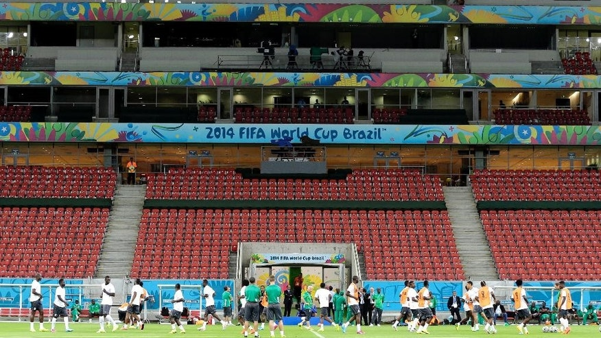 Ivory Coast's players warm up during a training session of Ivory Coast at the Arena Pernambuco  in Recife, Brazil, Friday, June 13, 2014.  Ivory Coast play in group C of the 2014 soccer World Cup. (AP Photo/Shuji Kajiyama)
