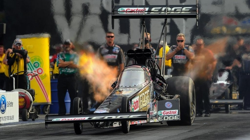 In this photo provided by NHRA, Top Fuel driver Brittany Force races to the qualifying lead Friday at the Ford NHRA Thunder Valley Nationals at Bristol Dragway. Force led the category with a performance of 3.828 seconds at 317.94 mph at the NHRA Mello Yello Drag Racing Series event. If the time holds through Saturday's qualifying, it will be her second No. 1 qualifying position of the season. (AP Photo/NHRA,Teresa Long)