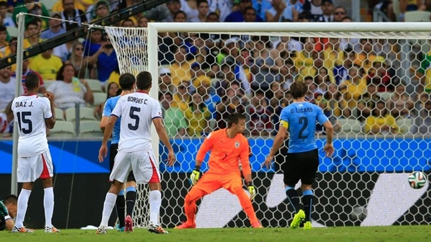 June 14, 2014: Costa Rica's Oscar Duarte scores his sides second goal during the group D World Cup soccer match between Uruguay and Costa Rica at the Arena Castelao in Fortaleza, Brazil. (AP)