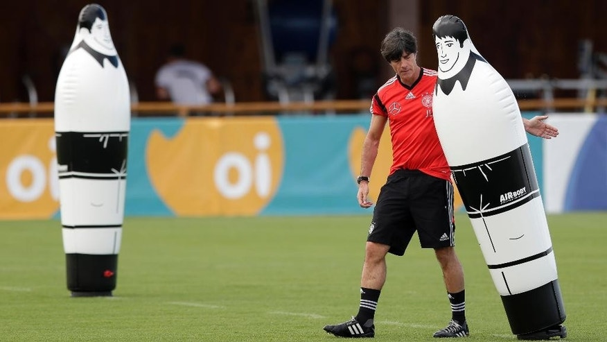 German national soccer team head coach Joachim Loew prepares for a training session in Santo Andre near Porto Seguro, Brazil, Saturday, June 14, 2014. Germany will play in group G of the 2014 soccer World Cup. (AP Photo/Matthias Schrader)