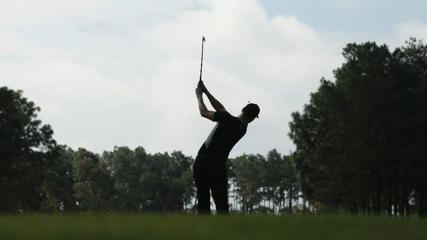 Martin Kaymer, of Germany, watches his tee shot on the 17th hole during the second round of the U.S. Open golf tournament in Pinehurst, N.C., Friday, June 13, 2014. (AP Photo/Charlie Riedel)