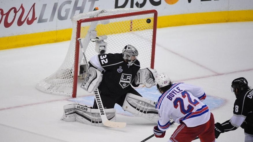 New York Rangers center Brian Boyle's shot hits the back of the net for a goal as Los Angeles Kings goalie Jonathan Quick looks on during the second period in Game 5 of the NHL Stanley Cup Final series Friday, June 13, 2014, in Los Angeles. (AP Photo/Mark J. Terrill)