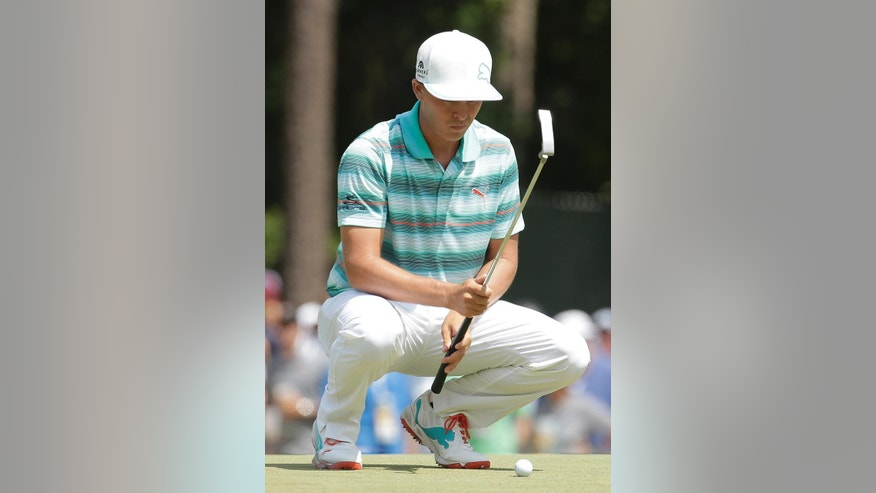 Rickie Fowler lines up his putt on the sixth hole during the third round of the U.S. Open golf tournament in Pinehurst, N.C., Saturday, June 14, 2014. (AP Photo/Charlie Riedel)