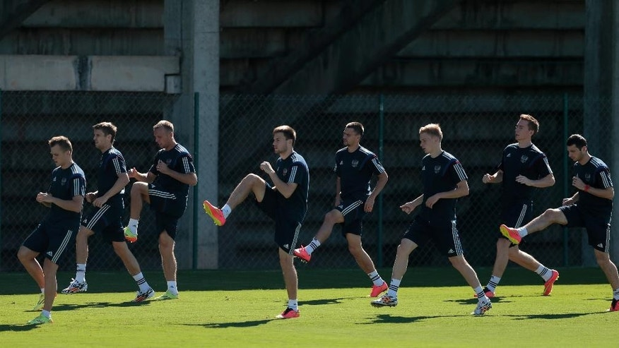 Team Russia players warm up during a training session in Itu, Brazil, on Wednesday, June 11, 2014. Russia will play in group H of the 2014 soccer World Cup. (AP Photo/Ivan Sekretarev)