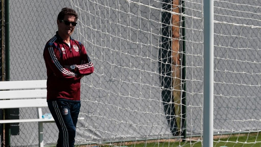 Fabio Capello, Italian head coach of Russian national soccer team walks during a training session in Itu, Brazil, on Wednesday, June 11, 2014. Russia will play in group H of the 2014 soccer World Cup. (AP Photo/Ivan Sekretarev)
