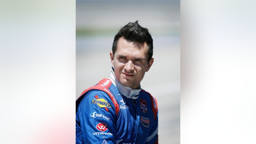 IndyCar driver Mikhail Aleshin looks on during track testing, Friday, June 13, 2014, at Iowa Speedway in Newton, Iowa. All anyone in IndyCar seems to know about Aleshin is that he's Russian, the first in fact, in series history. But the Moscow native is coming off back-to-back top-10 finishes and could be primed for rookie of the year honors if he keeps improving. (AP Photo/Charlie Neibergall)