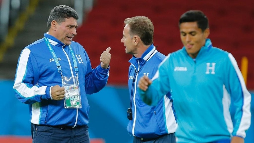 Luis Fernando Suarez, head coach of Honduras' soccer team, left, talks with an  assistant during a training session at the Estadio Beira-Rio in Porto Alegre, Brazil, Saturday, June 14, 2014. Honduras will play in E group of the Brazil 2014 World Cup. (AP Photo/David Vincent)