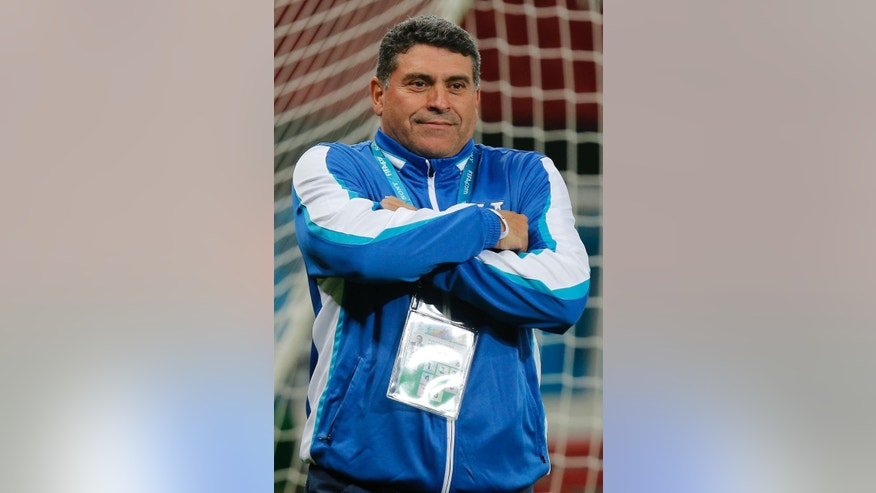 Luis Fernando Suarez, head coach of Honduras' soccer team, gestures on the pitch during a training session at the Estadio Beira-Rio in Porto Alegre, Brazil, Saturday, June 14, 2014. Honduras will play in E group of the Brazil 2014 World Cup. (AP Photo/David Vincent)