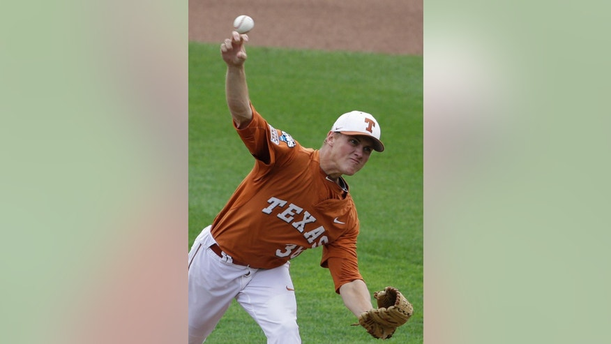 RETRANSMISSION TO CORRECT TEAM - Texas pitcher Nathan Thornhill (36) delivers against UC Irvine in the first inning of an NCAA baseball College World Series game in Omaha, Neb., Saturday, June 14, 2014. (AP Photo/Nati Harnik)