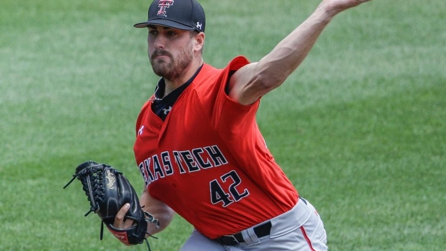Texas Tech pitcher Chris Sadberry (42) delivers against TCU in the first inning of an NCAA baseball College World Series game in Omaha, Neb., Sunday, June 15, 2014. (AP Photo/Nati Harnik)