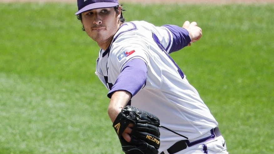 TCU pitcher Preston Morrison delivers against Texas Tech in the first inning of an NCAA baseball College World Series game in Omaha, Neb., Sunday, June 15, 2014. (AP Photo/Nati Harnik)