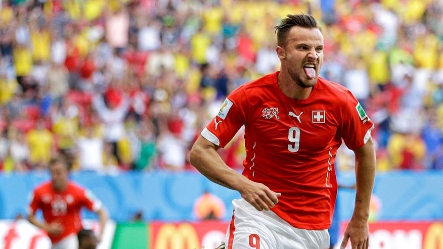 Switzerland's Haris Seferovic scores his side's second goal during the group E World Cup soccer match between Switzerland and Ecuador at the Estadio Nacional in Brasilia, Brazil, Sunday, June 15, 2014.  (AP Photo/Michael Sohn)
