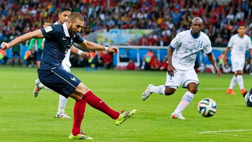 June 15, 2014: France's Karim Benzema scores his side's third goal during the group E World Cup soccer match between France and Honduras at the Estadio Beira-Rio in Porto Alegre, Brazil.