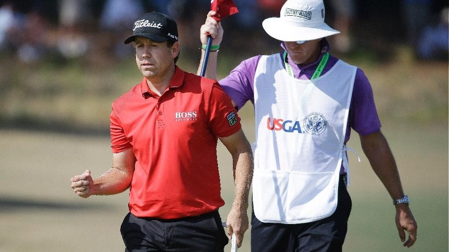 Erik Compton reacts to his birdie on the fifth hole during the final round of the U.S. Open golf tournament in Pinehurst, N.C., Sunday, June 15, 2014. (AP Photo/David Goldman)