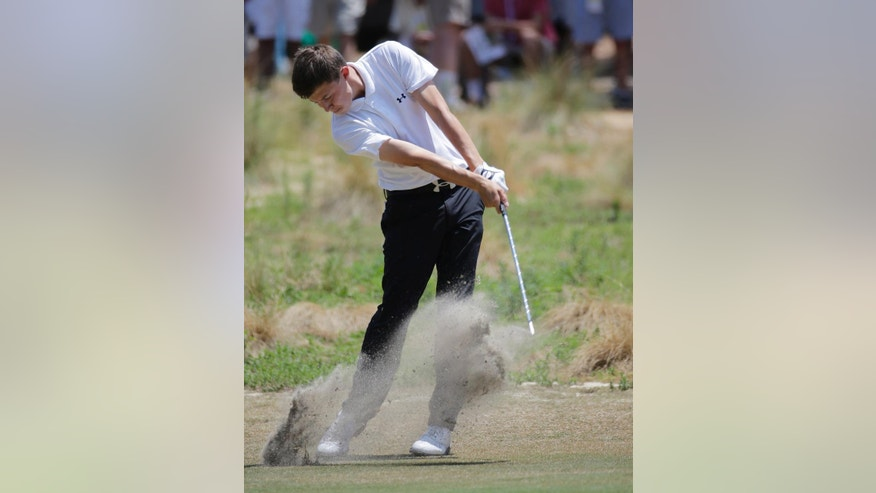 Amateur, Matthew Fitzpatrick, England, hits from the fairway on the 18th hole during the final round of the U.S. Open golf tournament in Pinehurst, N.C., Sunday, June 15, 2014. (AP Photo/Eric Gay)