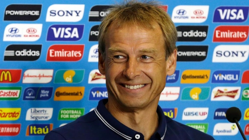 United States' head coach Jurgen Klinsmann attends a press conference before an official training session the day before the group G World Cup soccer match between Ghana and the United States at the Arena das Dunas in Natal, Brazil, Sunday, June 15, 2014. (AP Photo/Dolores Ochoa)