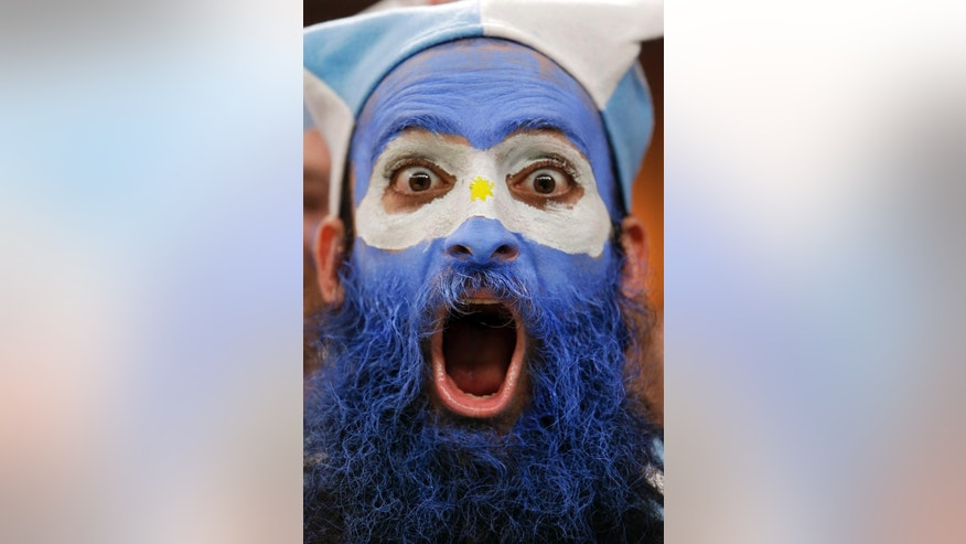 An Argentine supporter yells during the group F World Cup soccer match between Argentina and Bosnia at the Maracana Stadium in Rio de Janeiro, Brazil, Sunday, June 15, 2014. (AP Photo/Thanassis Stavrakis)