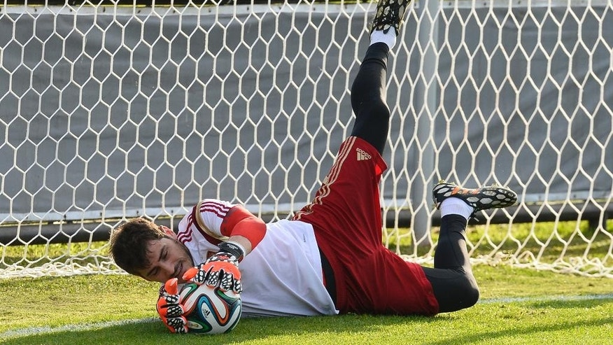Spain's goalkeeper Iker Casillas saves a ball during a training session at he Atletico Paranaense training center in Curitiba, Brazil, Saturday, June 14, 2014. Spain will play in group B of the Brazil 2014 World Cup. (AP Photo/Manu Fernandez)