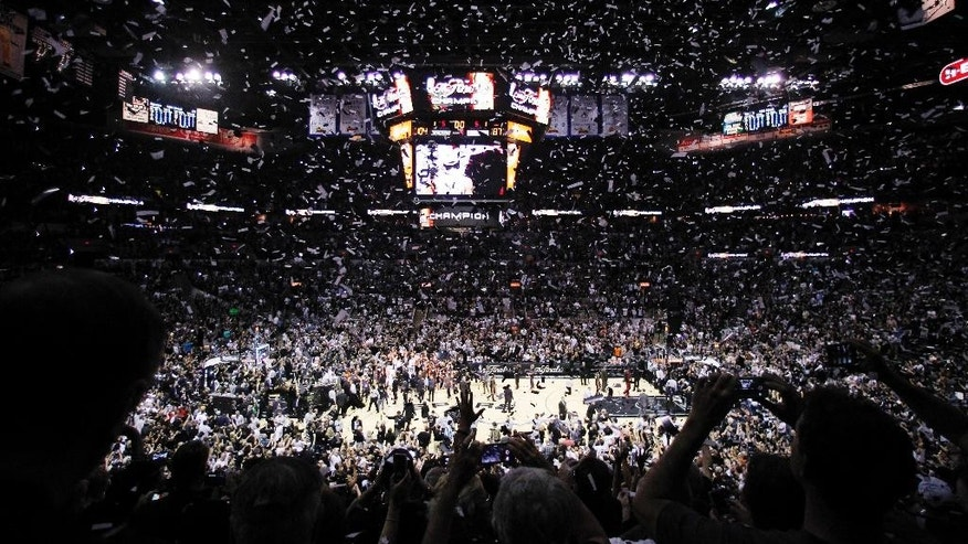 Confetti falls after Game 5 of the NBA basketball finals between the San Antonio Spurs and the Miami Heat on Sunday, June 15, 2014, in San Antonio. San Antonio won the NBA championship 104-87. (AP Photo/Tony Gutierrez)