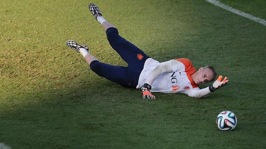 Goal keeper Jasper Cillessen of the Netherlands dives for the ball during a training session in Rio de Janeiro, Brazil, Sunday, June 15, 2014.  The Netherlands play in group B of the 2014 soccer World Cup. (AP Photo/Wong Maye-E)