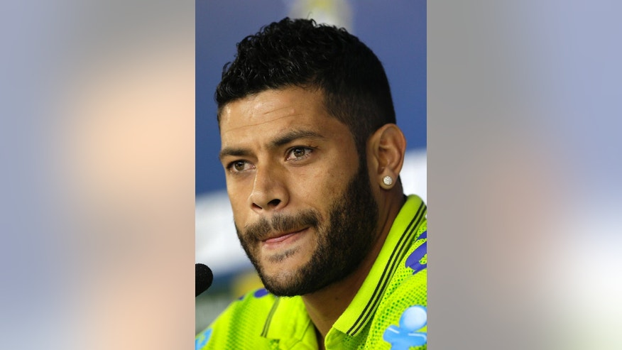 Brazil's Hulk looks listens to questions from the media during a news conference after a training session of the Brazilian national soccer team at the Granja Comary training center in Teresopolis, Brazil, Sunday, June 15, 2014. Brazil plays in group A of the 2014 soccer World Cup. (AP Photo/Andre Penner)