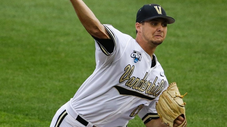 Vanderbilt pitcher Tyler Beede (11) delivers against UC Irvine in the first inning of an NCAA baseball College World Series game in Omaha, Neb., Monday, June 16, 2014. (AP Photo/Nati Harnik)