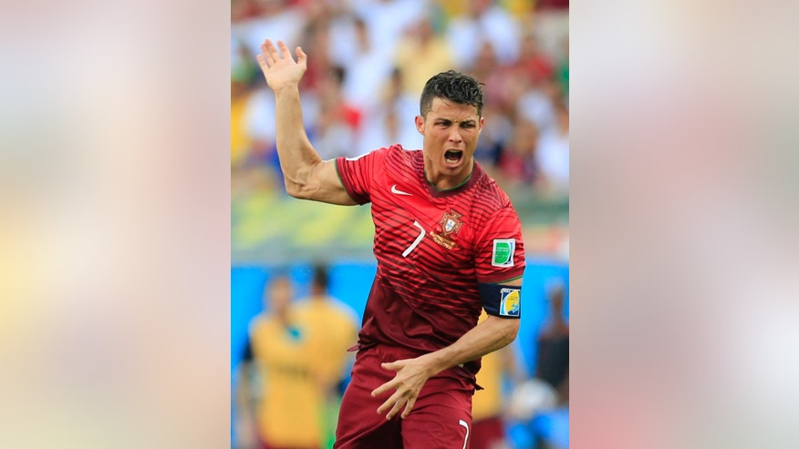 Portugal's Cristiano Ronaldo reacts during the group G World Cup soccer match between Germany and Portugal at the Arena Fonte Nova in Salvador, Brazil, Monday, June 16, 2014.  (AP Photo/Bernat Armangue)