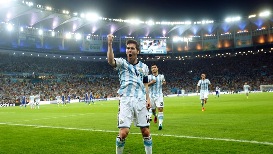 Argentina's Lionel Messi celebrates scoring his side's second goal during the group F World Cup soccer match between Argentina and Bosnia at the Maracana Stadium in Rio de Janeiro, Brazil.