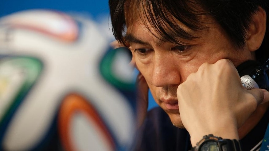 South Korea national soccer team coach Hong Myung-bo listens to reporter's question during a press conference the day before the group H World Cup soccer match between Russia and South Korea at the Arena Pantanal in Cuiaba, Brazil, Monday, June 16, 2014. (AP Photo/Lee Jin-man)