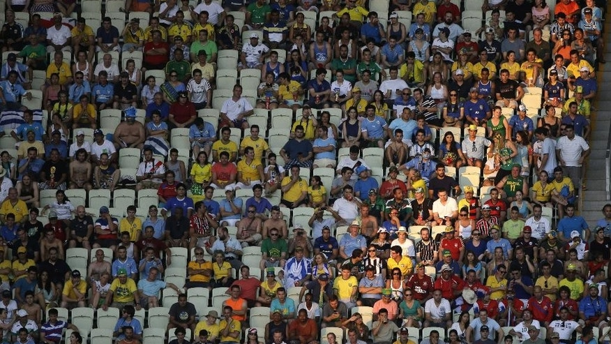 Seats are unoccupied during the group D World Cup soccer match between Uruguay and Costa Rica at the Arena Castelao in Fortaleza, Brazil, Saturday, June 14, 2014.  (AP Photo/Sergei Grits)