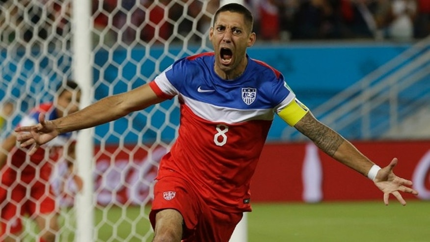 United States' Clint Dempsey celebrates after scoring the opening goal during the group G World Cup soccer match between Ghana and the United States at the Arena das Dunas in Natal, Brazil, Monday, June 16, 2014. The United States won the match 2-1. (AP Photo/Ricardo Mazalan)