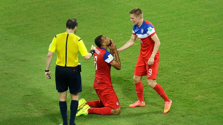 June 16, 2014: United States' John Brooks, center, celebrates with teammate Aron Johannsson after scoring their second goal during the group G World Cup soccer match between Ghana and the United States.