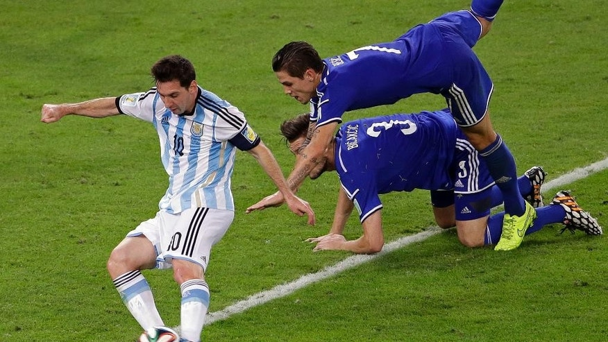 Argentina's Lionel Messi, left, scores his side's second goal during the group F World Cup soccer match between Argentina and Bosnia at the Maracana Stadium in Rio de Janeiro, Brazil, Sunday, June 15, 2014.  (AP Photo/Sergei Grits)
