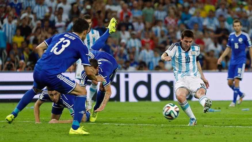 Argentina's Lionel Messi scores his side's second goal during the group F World Cup soccer match between Argentina and Bosnia at the Maracana Stadium in Rio de Janeiro, Brazil, Sunday, June 15, 2014.     (AP Photo/Victor R. Caivano)