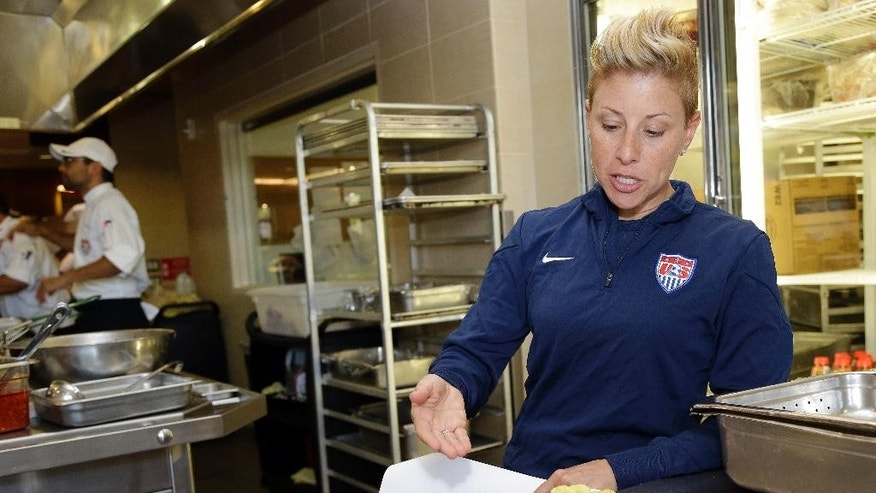 In this photo taken May 21, 2014, U.S. soccer sports performance dietitian Danielle LaFata talks in Stanford, Calif., about the team's food menu as the team trains in preparation for the World Cup soccer tournament in Brazil. Long before the U.S. team traveled to Brazil in June, chef Bryson Billapando and LaFata took a fact-finding mission to the team's hotels in Sao Paulo, Natal, Manaus and Recife to scour the kitchens and dining spaces and scout food options. (AP Photo/Marcio Jose Sanchez)