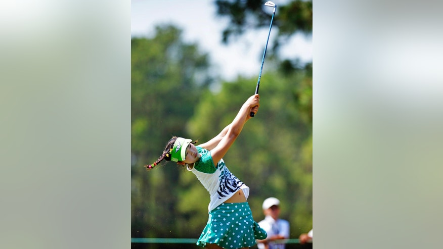 Amateur Lucy Li, 11, hits from the fairway on the 15th hole during a practice round at the U.S. Women's Open golf tournament at Pinehurst No. 2, Tuesday, June 17, 2014, in Pinehurst, N.C. The sixth-grader from California is the youngest qualifier in the history of the U.S. Women's Open.  (AP Photo/The Fayetteville Observer, Abbi O'Leary) MANDATORY CREDIT, MAGS OUT, NO SALES