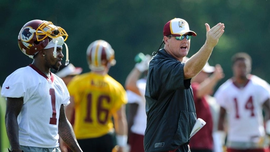 Washington Redskins head coach Jay Gruden, right, gestures next to wide receiver DeSean Jackson (1) during an NFL football minicamp, Tuesday, June 17, 2014, in Ashburn, Va. (AP Photo/Nick Wass)