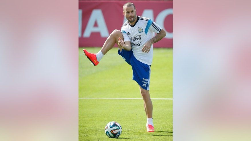 Argentina's Rodrigo Palacio warms up during a training session in Vespasiano, near Belo Horizonte, Brazil, Tuesday, June 17, 2014.  Argentina plays in group F of the 2014 soccer World Cup. (AP Photo/Victor R. Caivano)