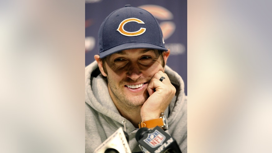 Chicago Bears quarterback Jay Cutler reacts to a question during a news conference after NFL football minicamp Tuesday, June 17, 2014, in Lake Forest, Ill. (AP Photo/Charles Rex Arbogast)