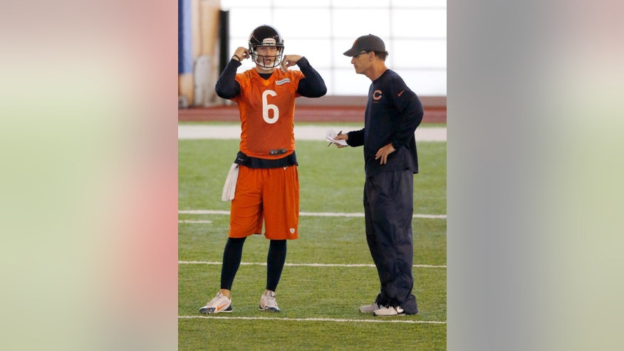 Chicago Bears quarterback Jay Cutler (6) talks to head coach Marc Trestman during NFL football minicamp Tuesday, June 17, 2014, in Lake Forest, Ill. (AP Photo/Charles Rex Arbogast)