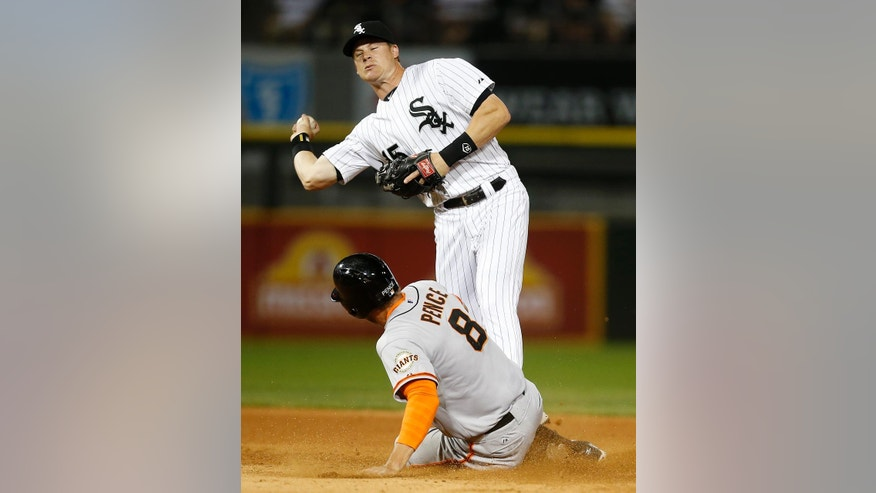 Chicago White Sox second baseman Gordon Beckham forces out San Francisco Giants' Hunter Pence on a double play during the seventh inning of a baseball game on Tuesday, June 17, 2014, in Chicago. (AP Photo/Andrew A. Nelles)
