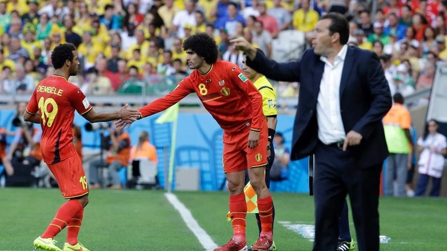 Belgium's Marouane Fellaini replaces Belgium's Mousa Dembele, left. during the group H World Cup soccer match between Belgium and Algeria at the Mineirao Stadium in Belo Horizonte, Brazil, Tuesday, June 17, 2014. (AP Photo/Hassan Ammar)