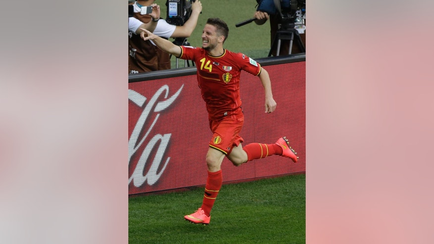 Belgium's Dries Mertens celebrates after scoring his side's second goal during the group H World Cup soccer match between Belgium and Algeria at the Mineirao Stadium in Belo Horizonte, Brazil, Tuesday, June 17, 2014. (AP Photo/Sergei Grits)