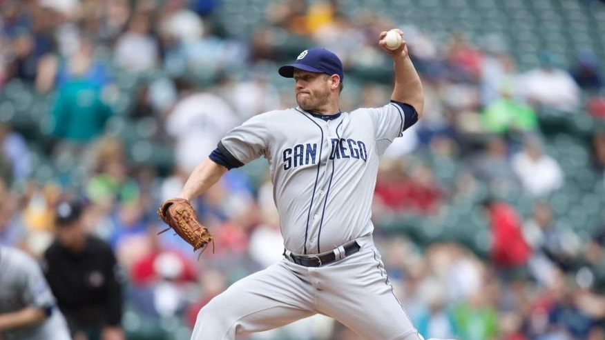 San Diego Padres starting pitcher Eric Stults delivers a pitch during the first inning a baseball game against the Seattle Mariners in Seattle, Tuesday, June 17, 2014. (AP Photo/Stephen Brashear)